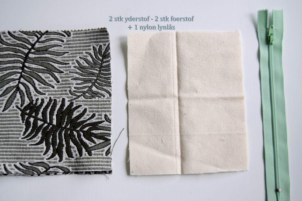 Sy lynlås og foer i en lille taske eller pung